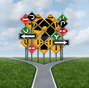 Confusing direction decision questions deciding on a clear strategy for solutions in business with a crossroads path to success choosing the right strategic plan with the challenge of a group of confusing traffic signs as a guide.