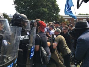 Image Credit: Evan Nesterak, CC BY 2.0 (Image Source: License: https://commons.wikimedia.org/wiki/File:White_supremacists_clash_with_police_(36421659232).jpghttps://creativecommons.org/licenses/by/2.0/deed.en)